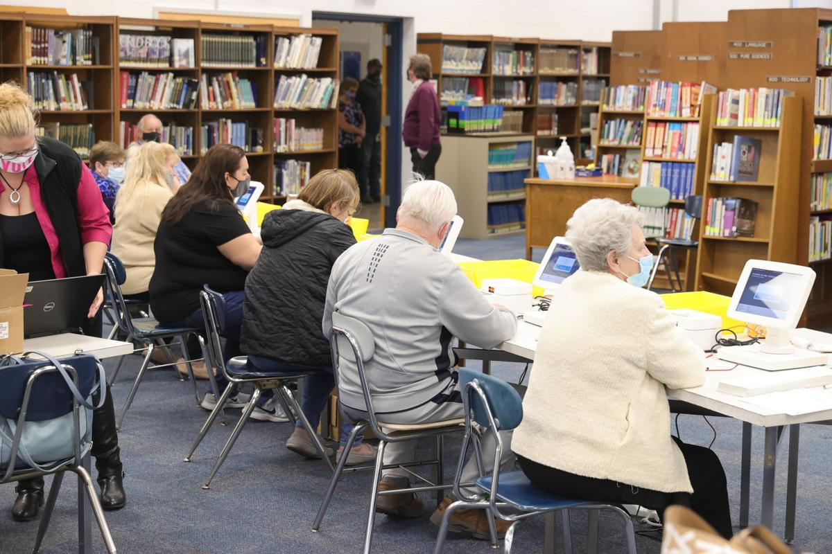Poll workers use expresspolls in library